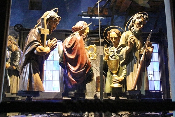 figurines of the Apostles behind a window