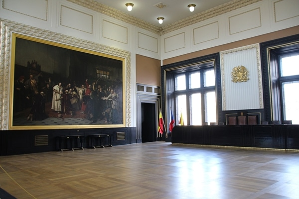 a large open room with a giant painting on one wall
