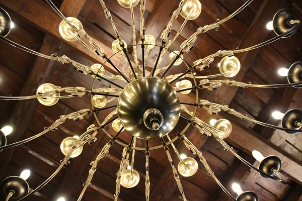 a gold chandelier viewed from below