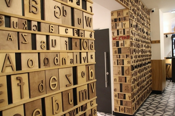 interior of a restaurant with letter blocks decorating the walls