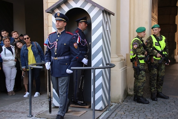 2 soldiers in blue uniforms in a changing of the guard ceremony