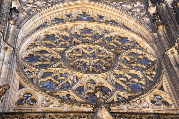 close up of a large round picture window on a church