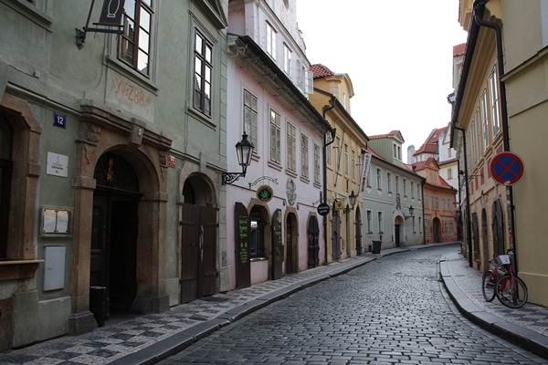 an empty cobblestone street with colorful buildings