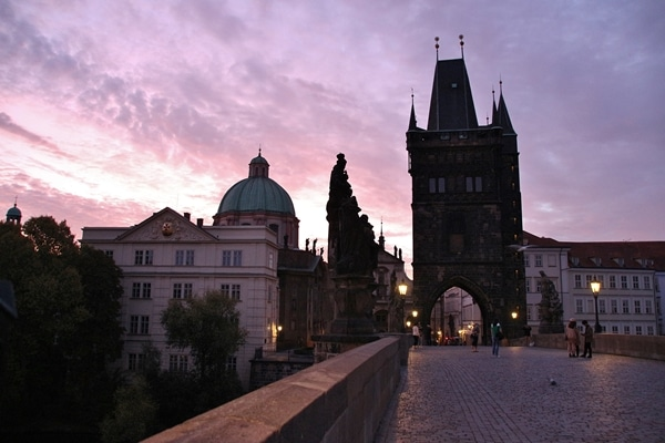 view of Charles Bridge and Old Town Bridge Tower at dawn