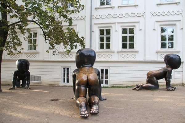 view of metal statues of crawling babies