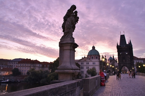 statue on Charles Bridge at dawn