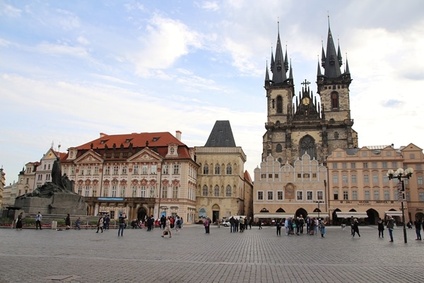 a mostly empty square in Prague with a large church