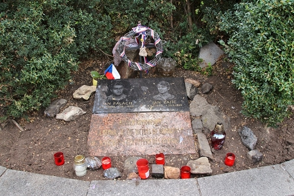a small monument surrounded by red candles