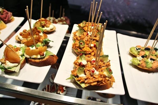 a close up of open-faced sandwiches with skewers in them