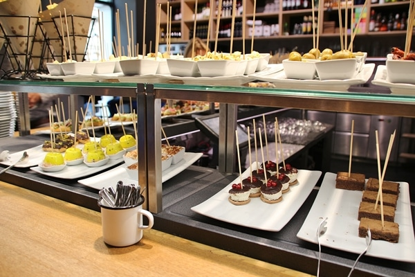 a buffet line with various foods on sticks