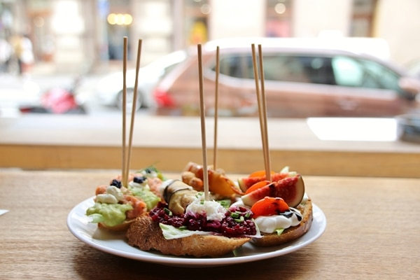 side view of sandwiches on a plate overlooking a street