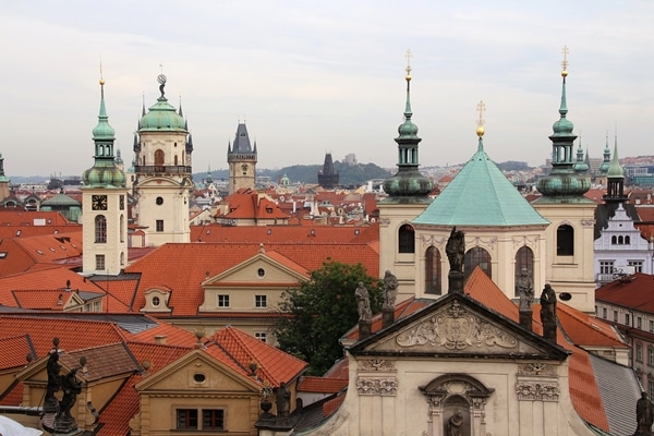 skyline of Prague with spires and red roofs