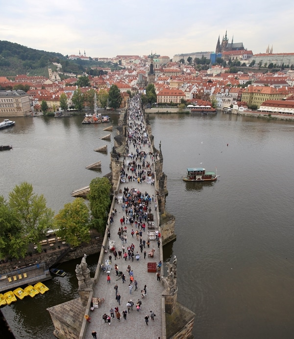 view of Charles Bridge and Prague Castle from a bridge tower