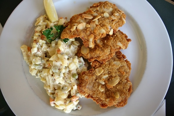 a plate of schnitzel and potato salad