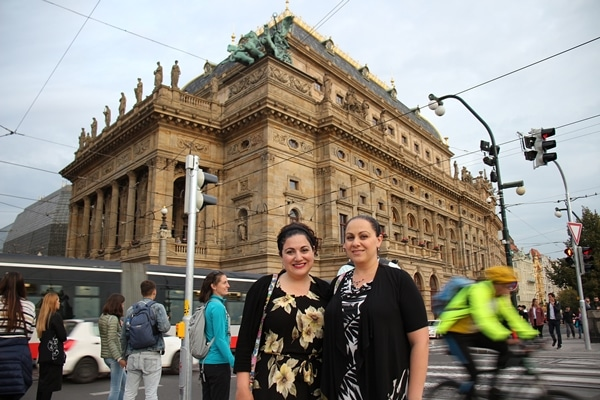 2 women in front of the National Opera building in Prague
