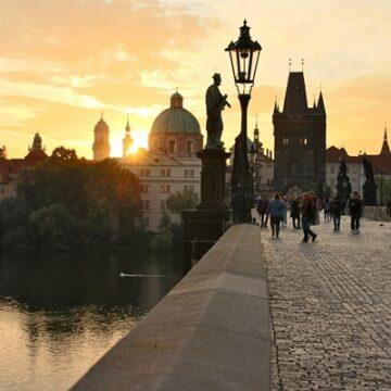 Sunrise in Prague over the Charles Bridge