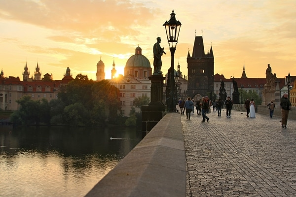 sunrise over the Charles Bridge and Vltava River in Prague