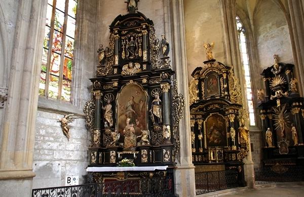 ornate altars inside a church