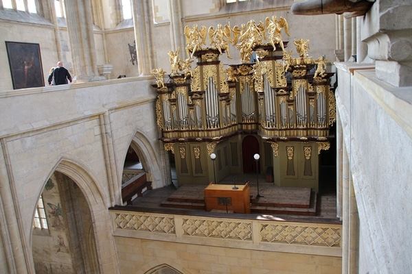 large church organ with gold figurines on top