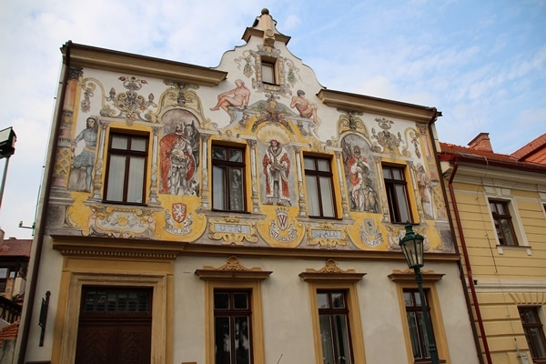 a building with colorful frescoes painted on it