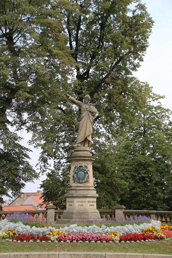 a statue under some trees
