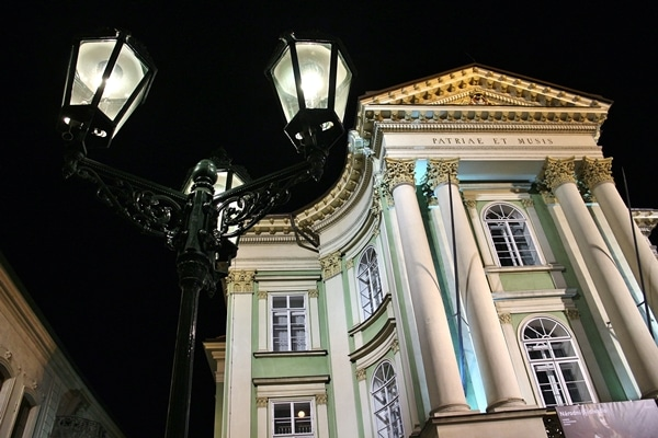a streetlamp in front of a building at night