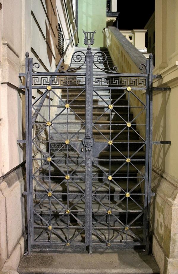 an ornate gate at night