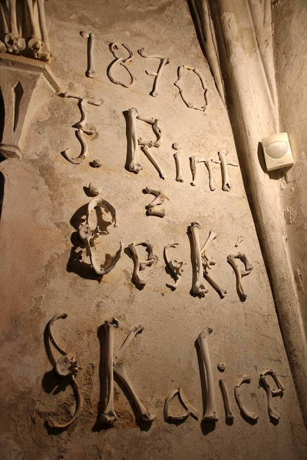 words written on a wall with human bones