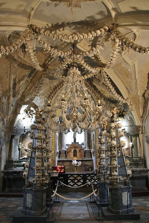 the interior of a bone church with a bone chandelier