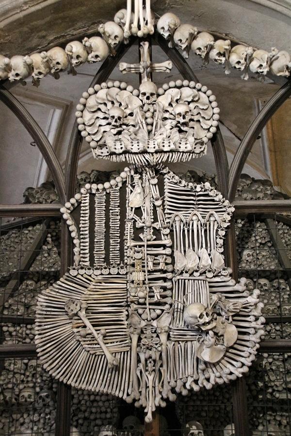 closeup of a family shield made of human bones
