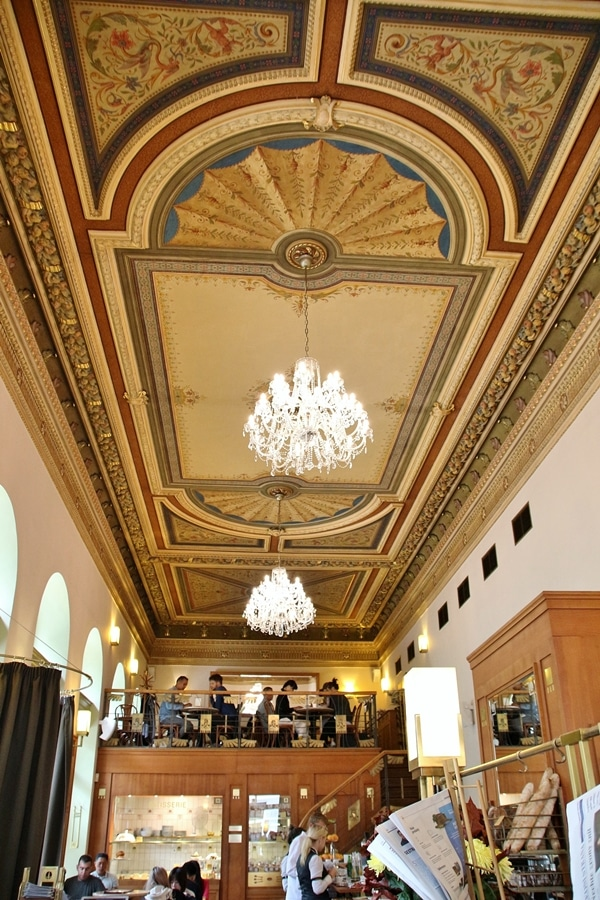 colorfully painted restaurant ceiling with glass chandeliers