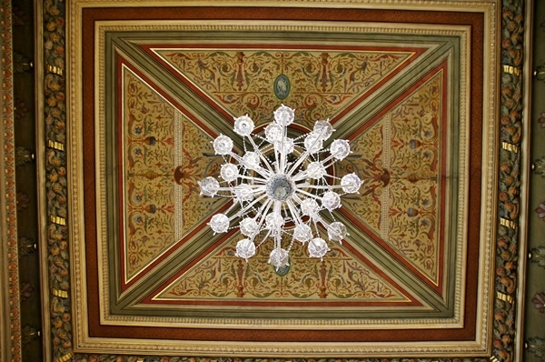 an elaborately decorated vaulted ceiling with a glass chandelier