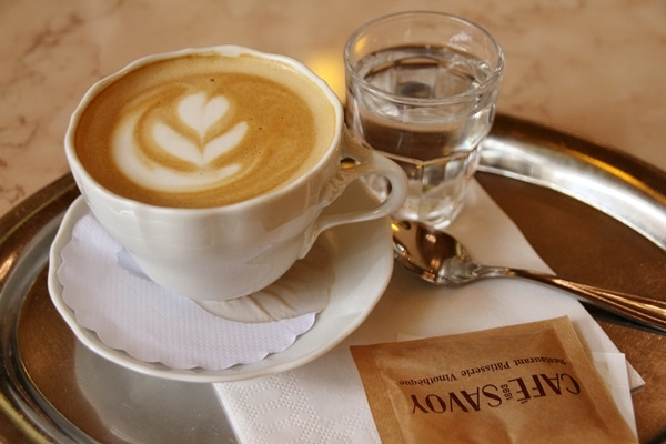 a cappuccino and a small glass of water