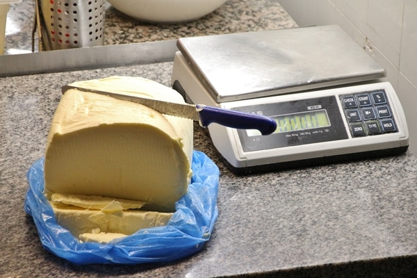a large slab of butter next to a digital scale