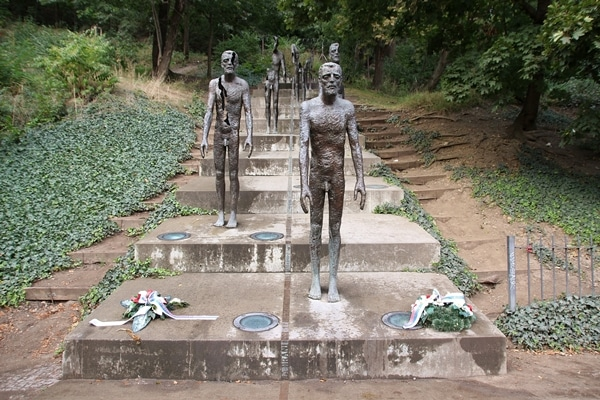 statues of men on stairs
