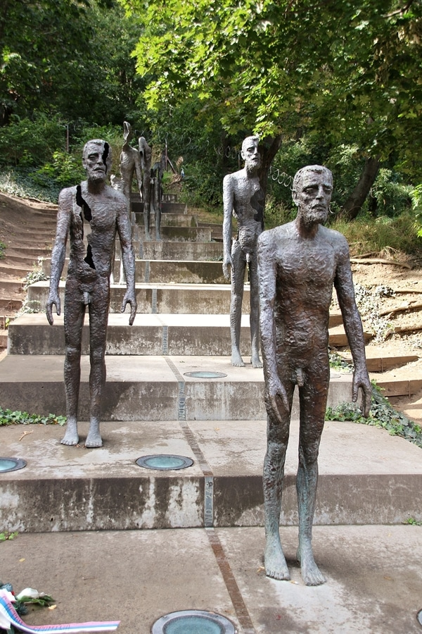 statues of men standing on steps