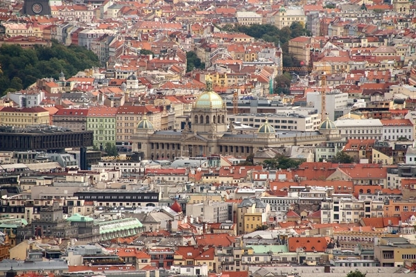 A view of Prague with large buildings in the background