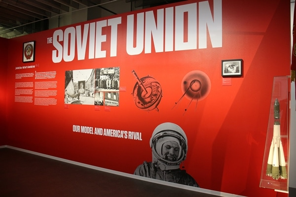 """a red wall in a museum that says \""""Soviet Union\"""""""
