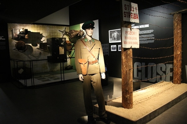 a museum display with a man in uniform
