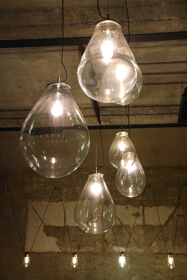 giant light bulbs hanging from a ceiling
