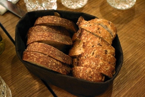 a bread basket with 2 varieties of bread