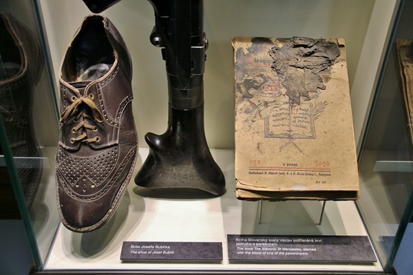 a shoe and book in a museum display