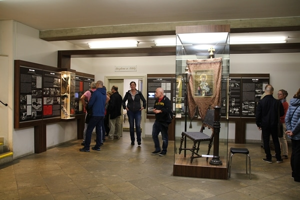 A group of people standing in a museum exhibit