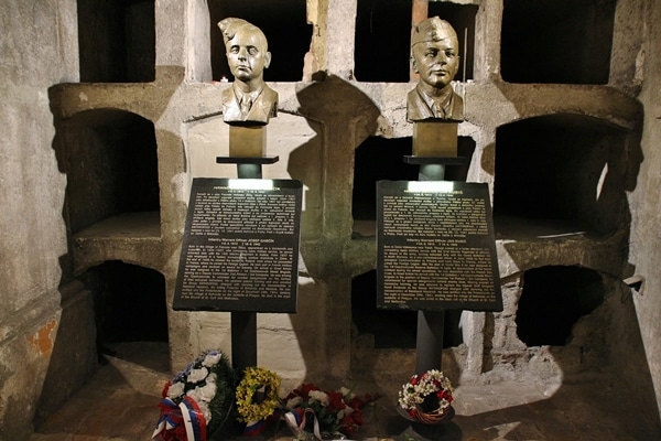 busts of people\'s heads in a crypt