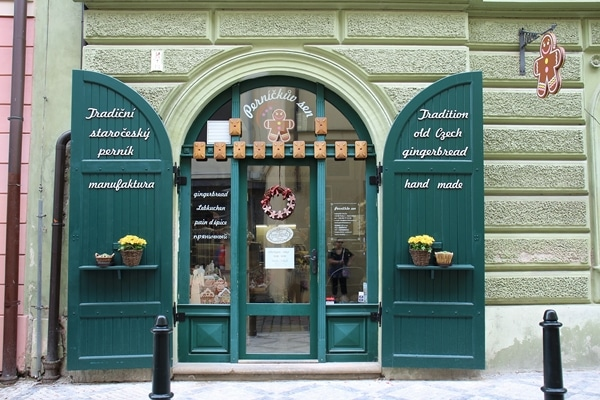 entrance to a gingerbread shop with green doors