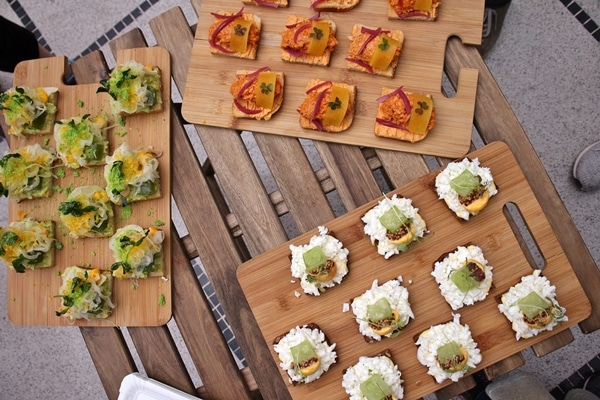 3 different varieties of open-faced sandwiches on wooden boards