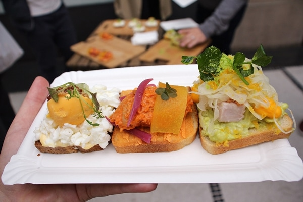 3 different varieties of open-faced sandwiches on a white plate