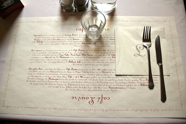 table setting in Cafe Louvre with paper placemat