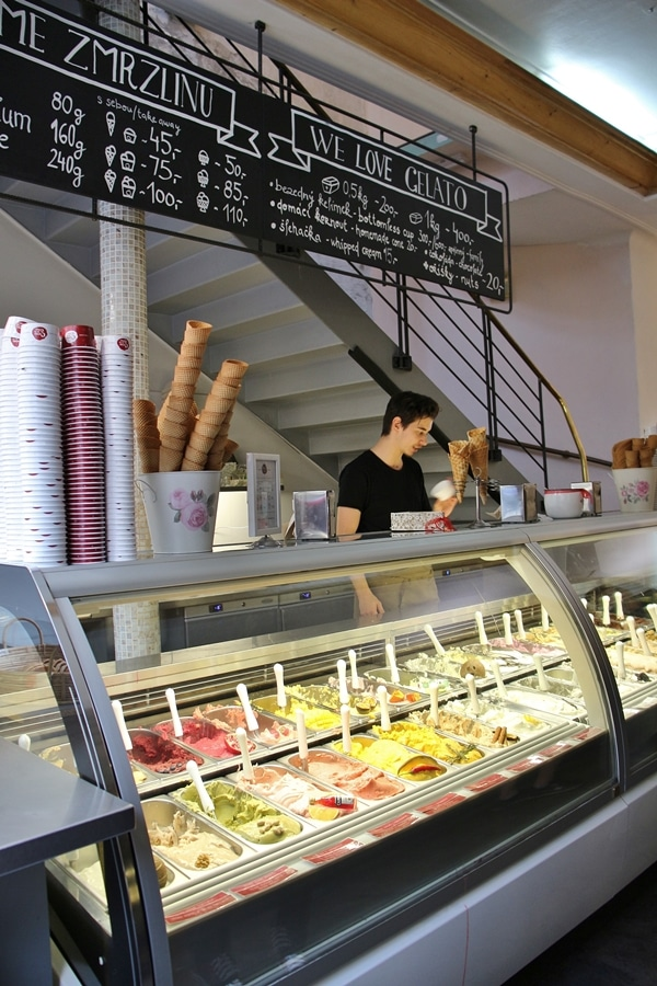 interior of an ice cream shop with a display case of gelatos and sorbets