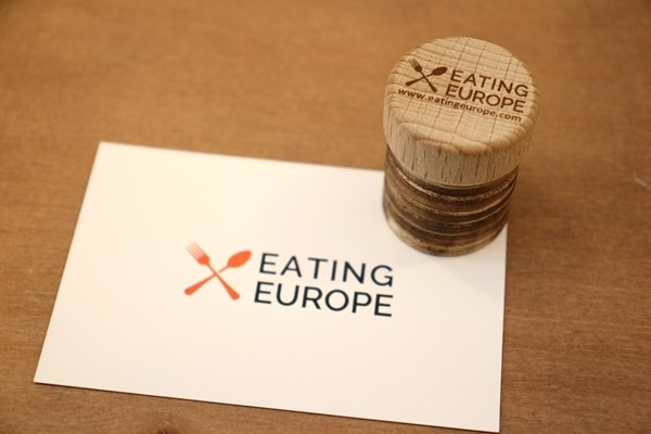 Eating Europe business card with a matching cork